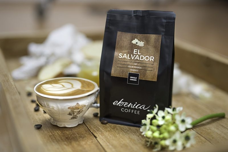 cappuccino in a cup and coffee package of El Salvador coffee