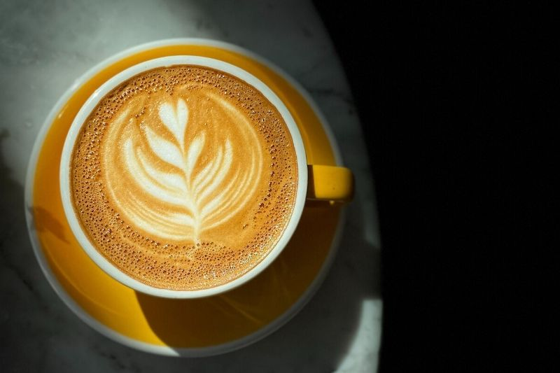 cappuccino in a yellow cup and saucer