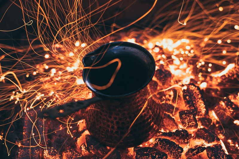 preparation of traditional Turkish coffee on coals